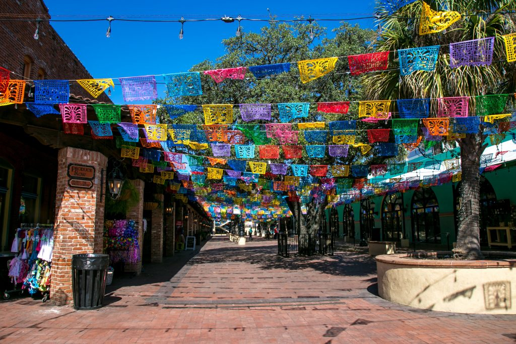 Colourful flags overhang historic Market Square, home to the landmark Mexican restaurant and bakery Mi Tierra.