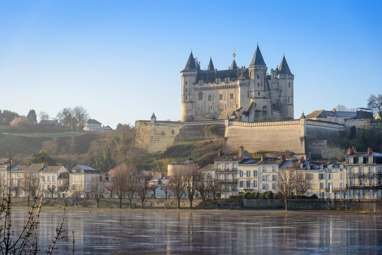 The 12th-century Château de Saumur towers