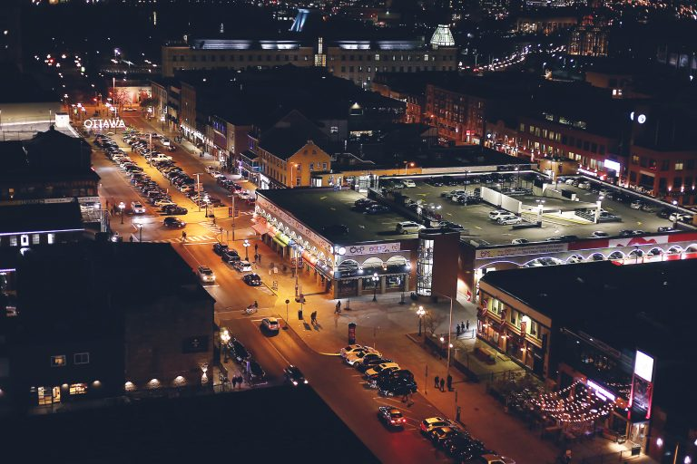 A nighttime view of Ottawa's ByWard Market from Copper Spirits and Sights, the rooftop bar at the Andaz Ottawa ByWard Market hotel.
