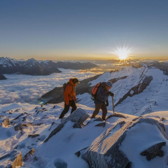 Hikers summit a peak in the Cariboo Mountains,