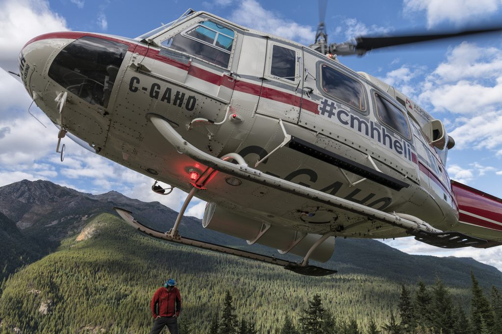 Guide John Mellis stands still as the helicopter ride arrives at the CMH Cariboos Lodge.