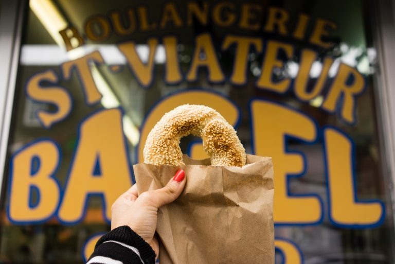 Picture of a bagel in front of St-Viateur bakery in Montreal's Mile End neighbourhood