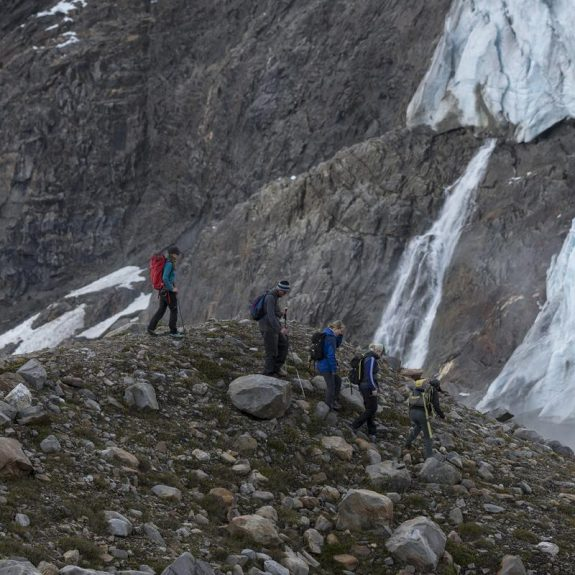Hikers traverse a rocky slope in eastern British Columbia's Cariboo Mountains.