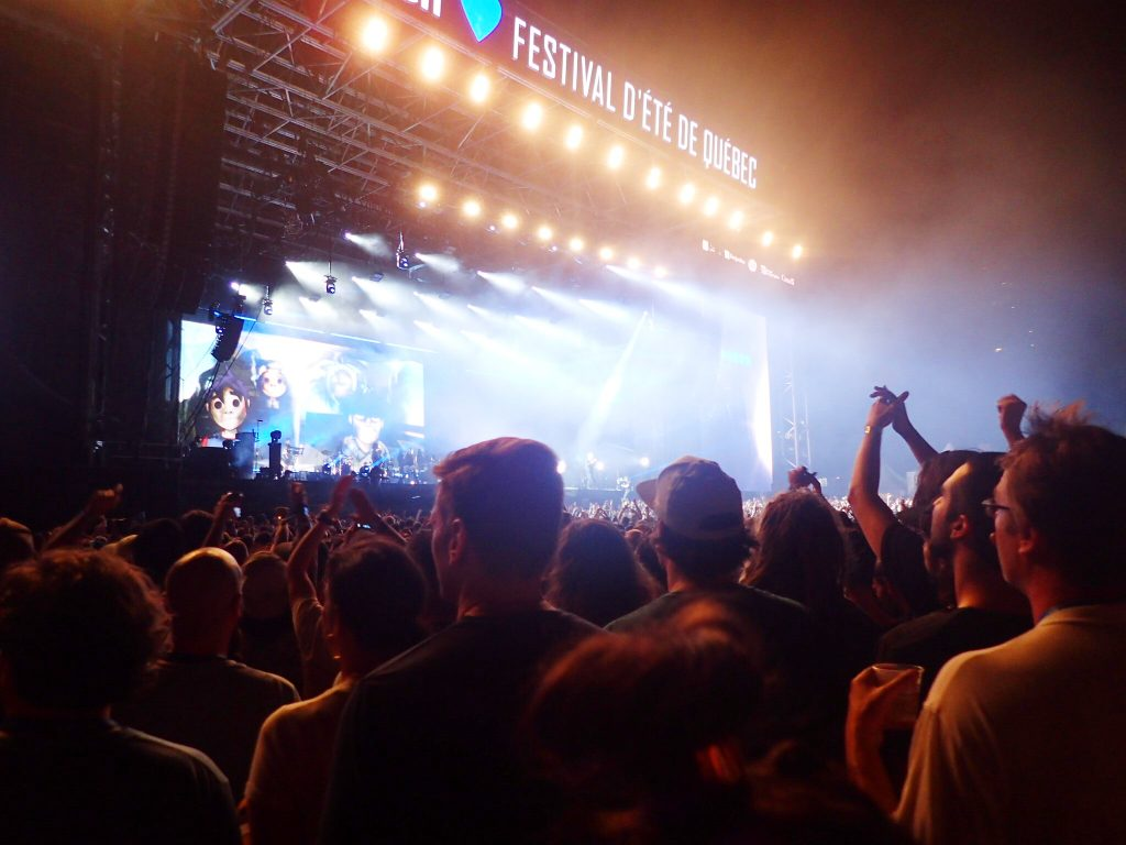 Music festival stage with crowds cheering