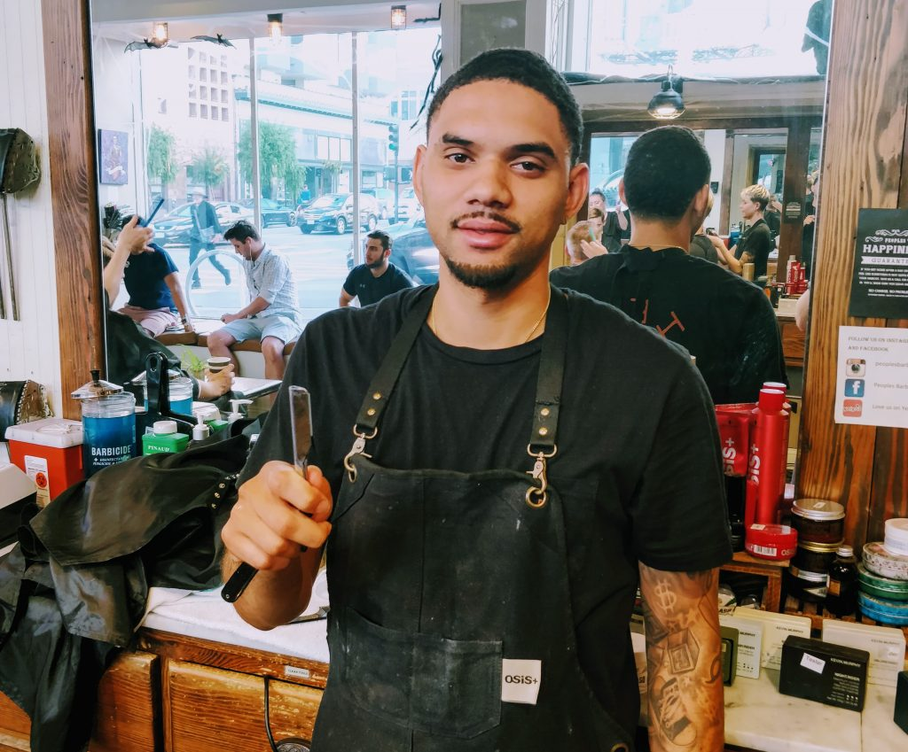 A barber holds a straight razor at Peoples Barber & Shop in San Francisco