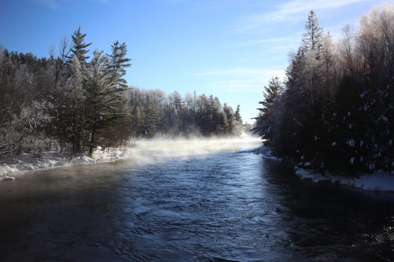 Steam rises from the Kipawa River in Quebec's Parc National d'Opémican on a frigid winter morning.
