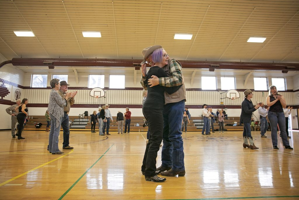 A couple embraces at a Cajun Dance workshop in Elko, Nevada