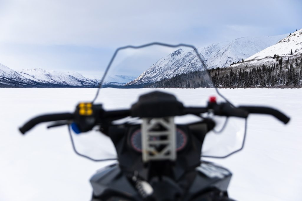 View of mountains through windshield of snowmobile