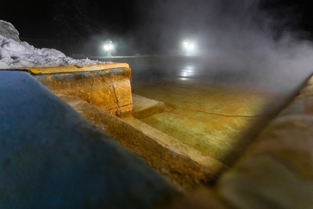 Nighttime view of a hot spring pool