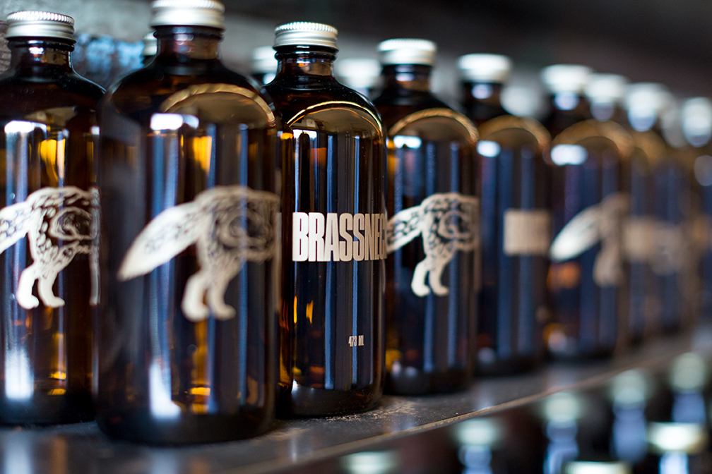 A row of growlers displayed in a microbrewery