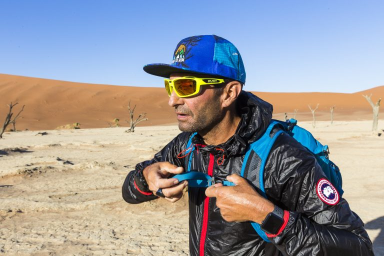 Ultra Runner Ray Zahab is pictured in a desert wearing an Apple Watch
