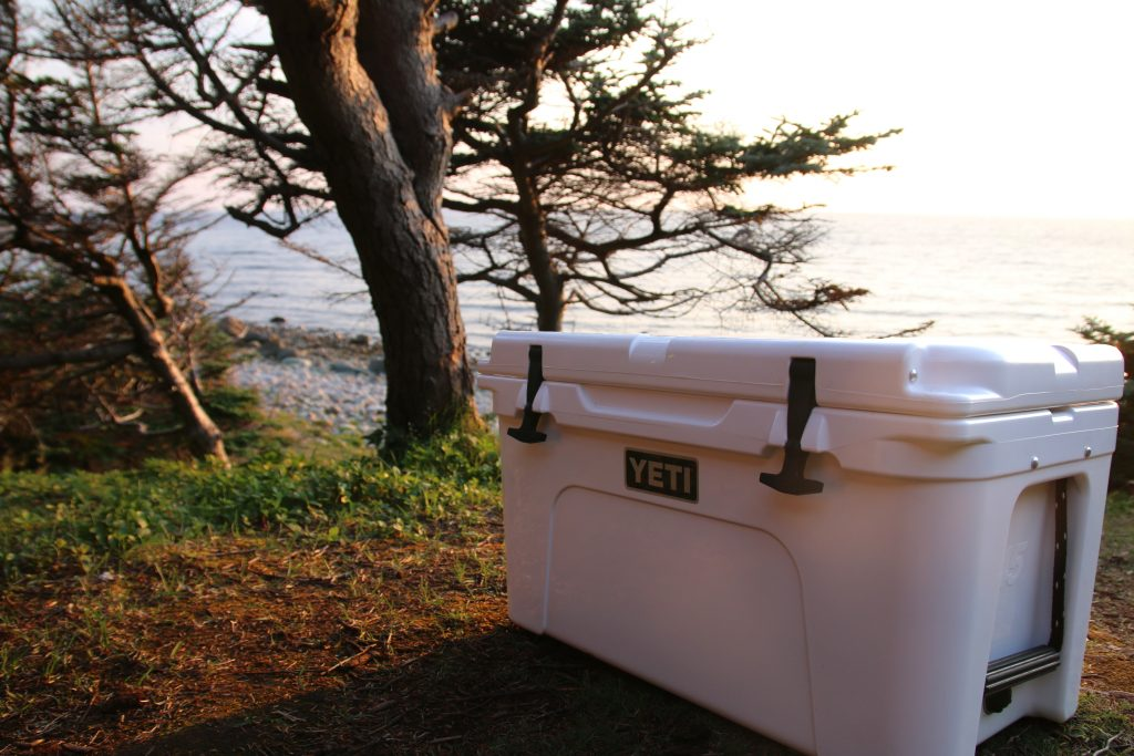 The yeti cooler in front of the shoreline at Gros Morne National Park, N.L.