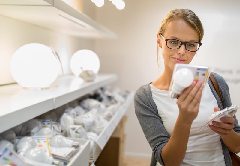 woman looking at lightbulb