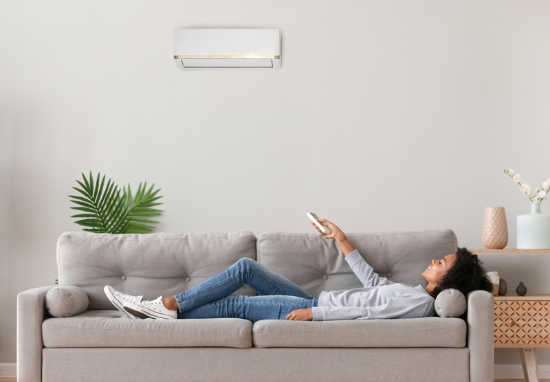heat pump woman on couch