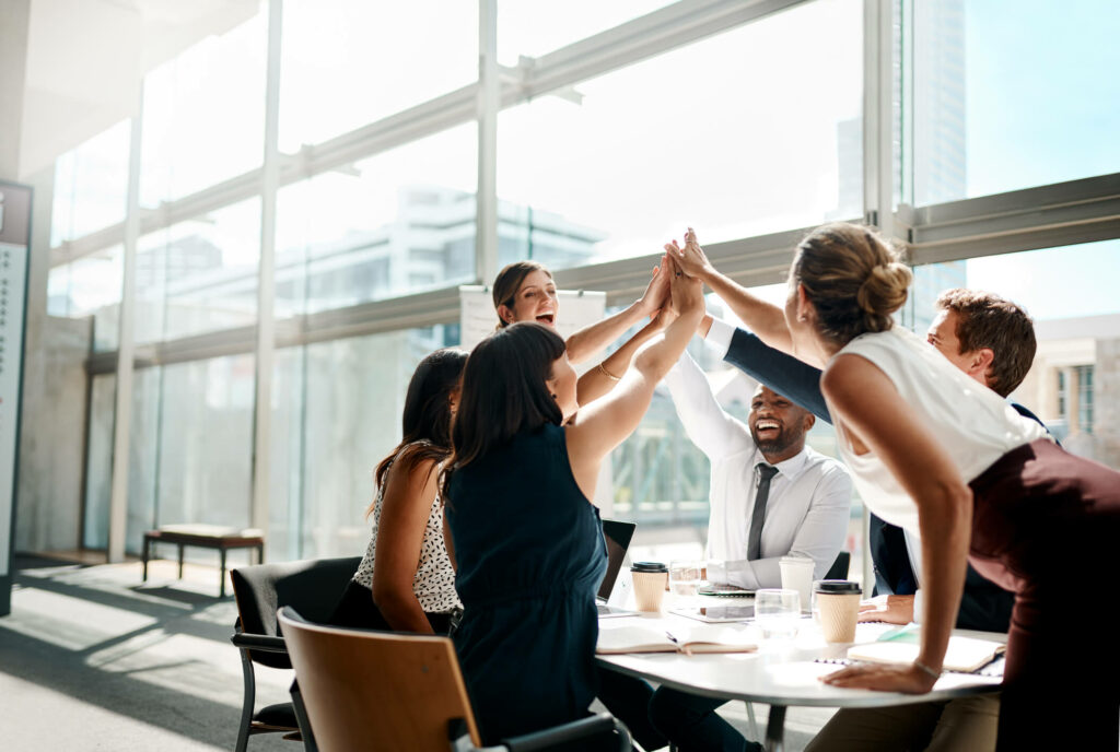 employees high five in office
