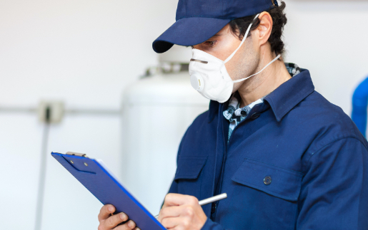 Man checking clipboard while wearing a mask