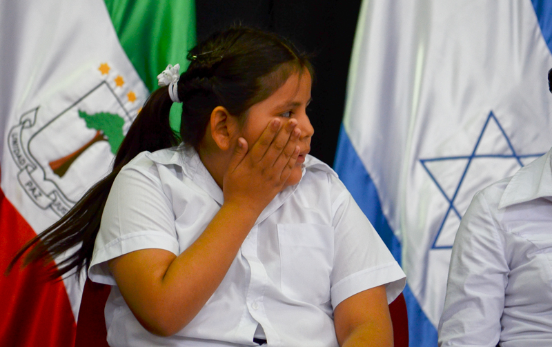 Sara Esthepani Rivas Mendoza holds her hand up to her face at aw