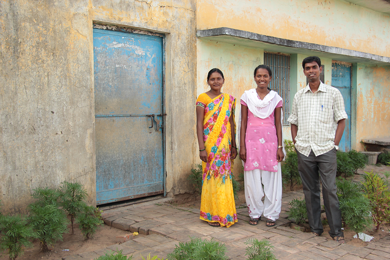 Sampatya with her tutor, Reena (left) and the centre director, Sam.