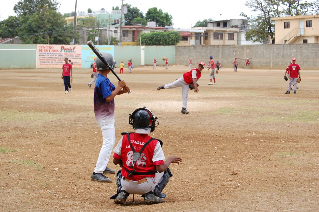 Boys playing baseball on a baseball diamond