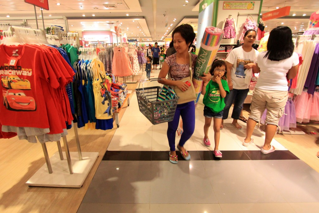 Maria Bea Morabe walks with her mother through a department store with clothes for sale