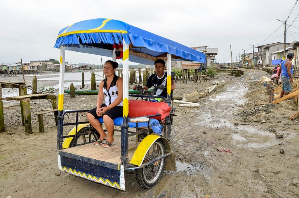 Dastin's dad, Miguel, at work transporting people on his moto-tricycle.