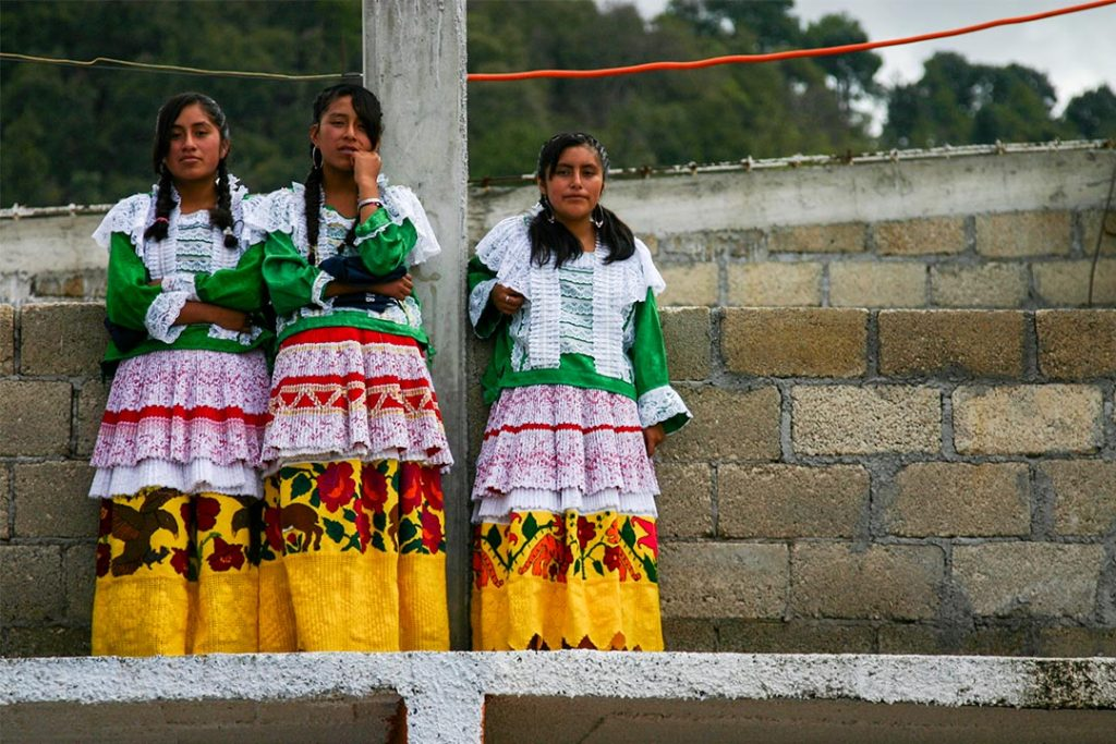 Girls in Mexico wearing traditional dress for a festival