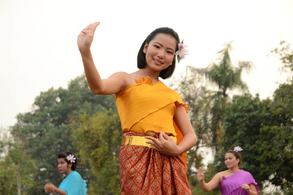 A young woman doing a traditional dance in Thailand.
