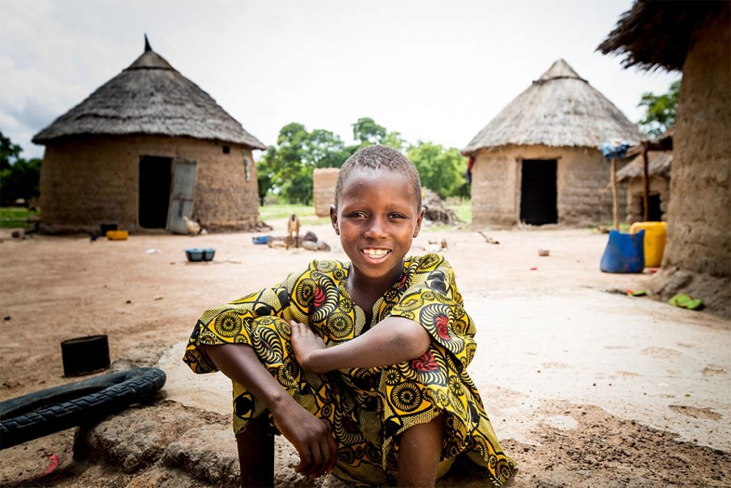 A boy in Burkina Faso at his family's compound