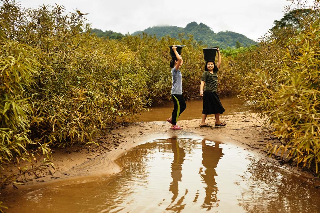 "Ae-plaetoo and Mue-ngaetoo gather water from this river each morning and each night near their home in northern Thailand. ""The water here, it's not clean and there's a lot of dirt. Because we get the water straight from the river, we need a filter."""