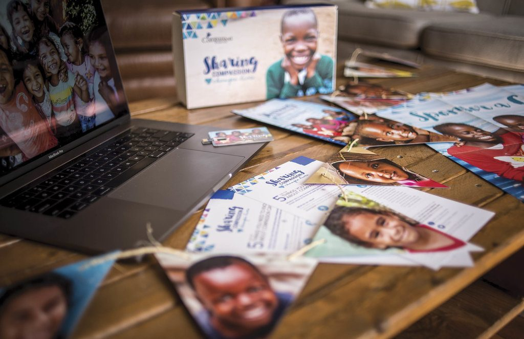 Pictures of Compassion children on a table.