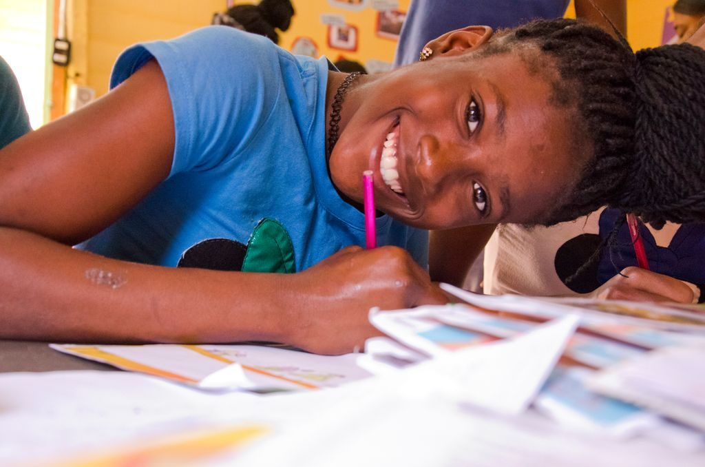 Arisleisy happily responds to a letter from her sponsor at her child development centre in the Dominican Republic.