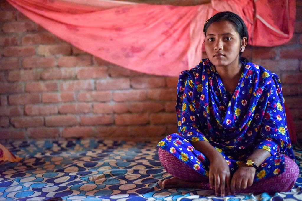 Ratna sits in her bedroom at her home in rural Bangladesh.