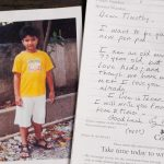 A picture of a boy in a yellow shirt next to a letter signed George Walker