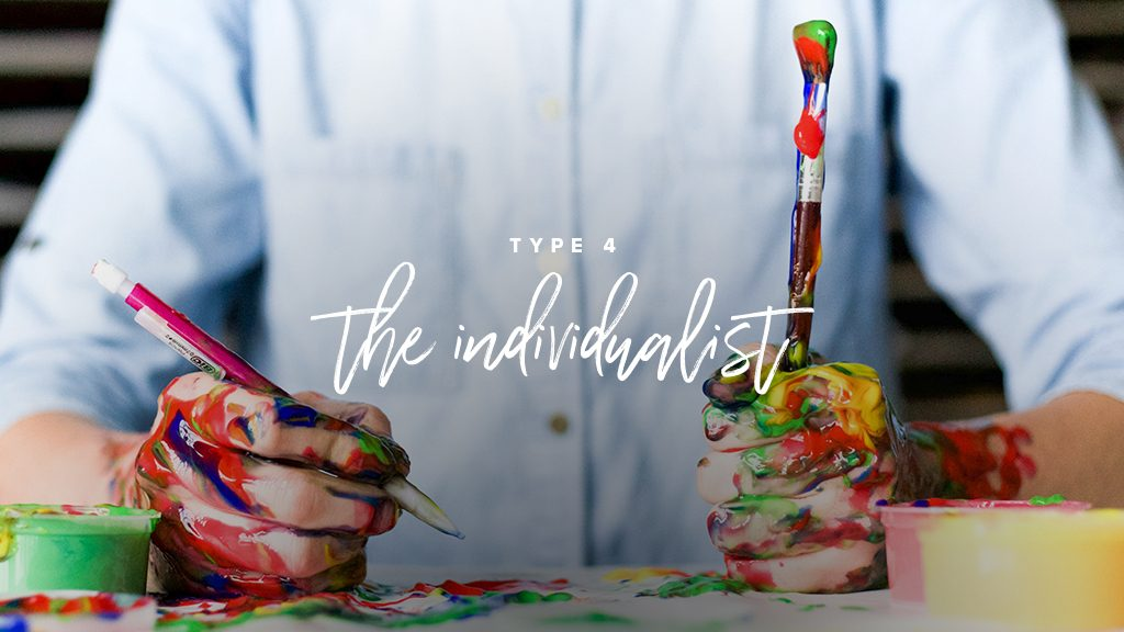 """type 4: the individualist"" a man with a bottom up shirt is holdsa paint brush and a pencil with his hands covered in paint."