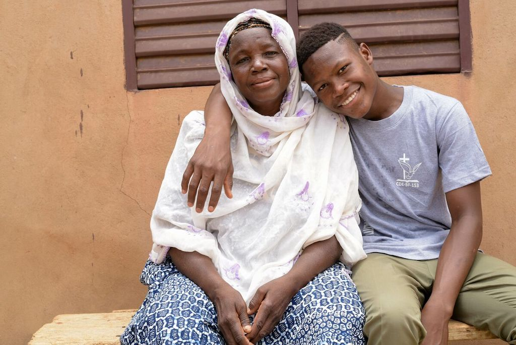 Abdoul poses with his grandmother, Alimata.