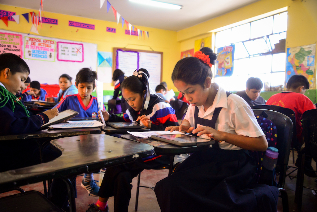 Students work intently at their desks.