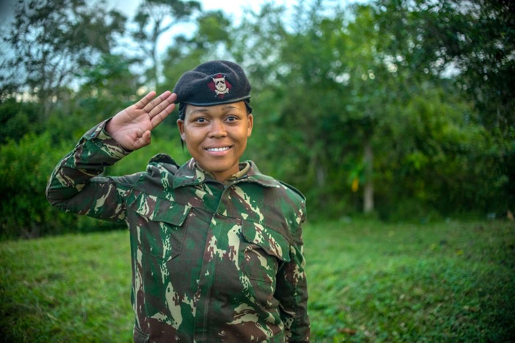 Miriam in her police uniform, performing a salute.