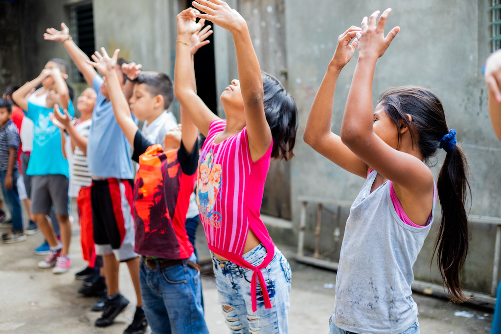 A group of Nicaraguan children doing stretches.
