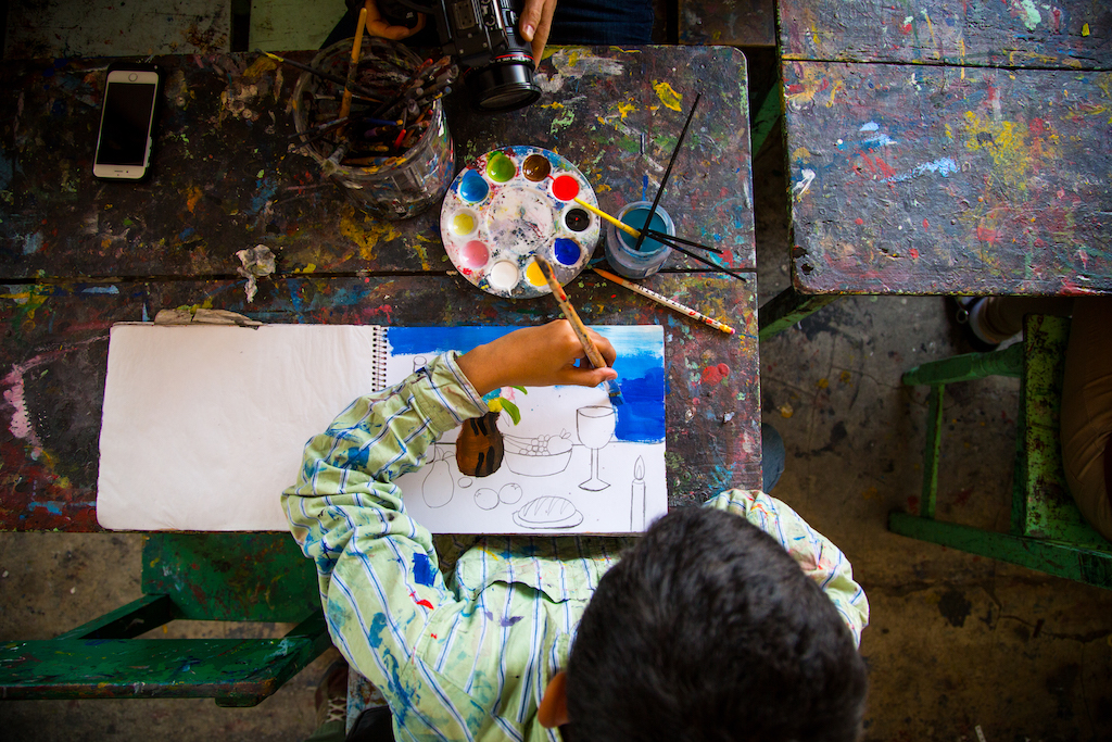 A child painting.