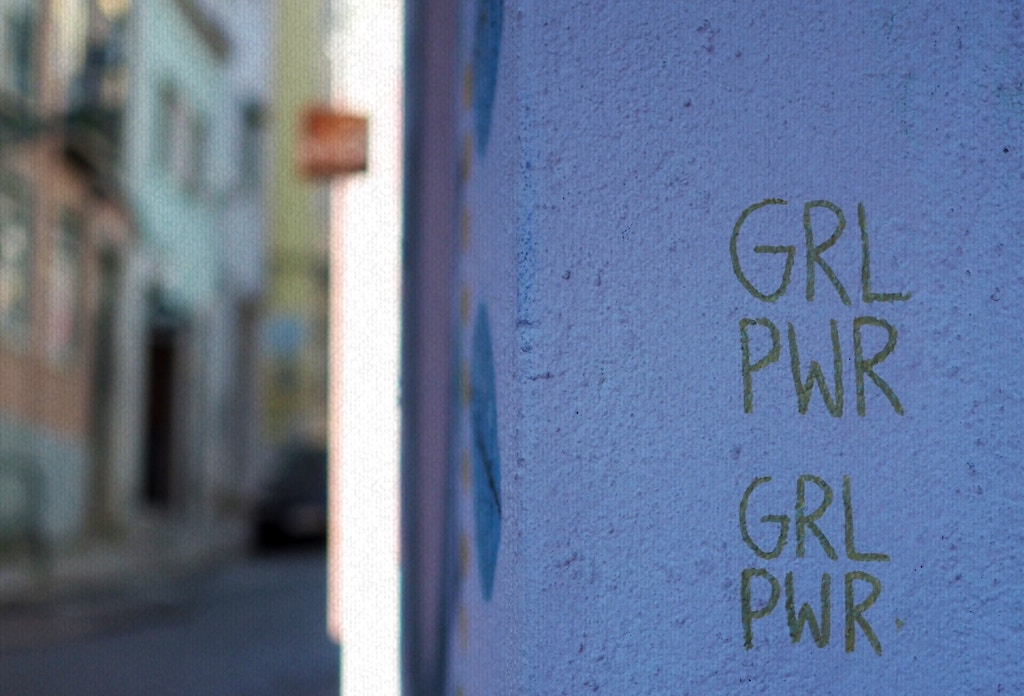 "A wall with ""GRL PWR"" written on it."