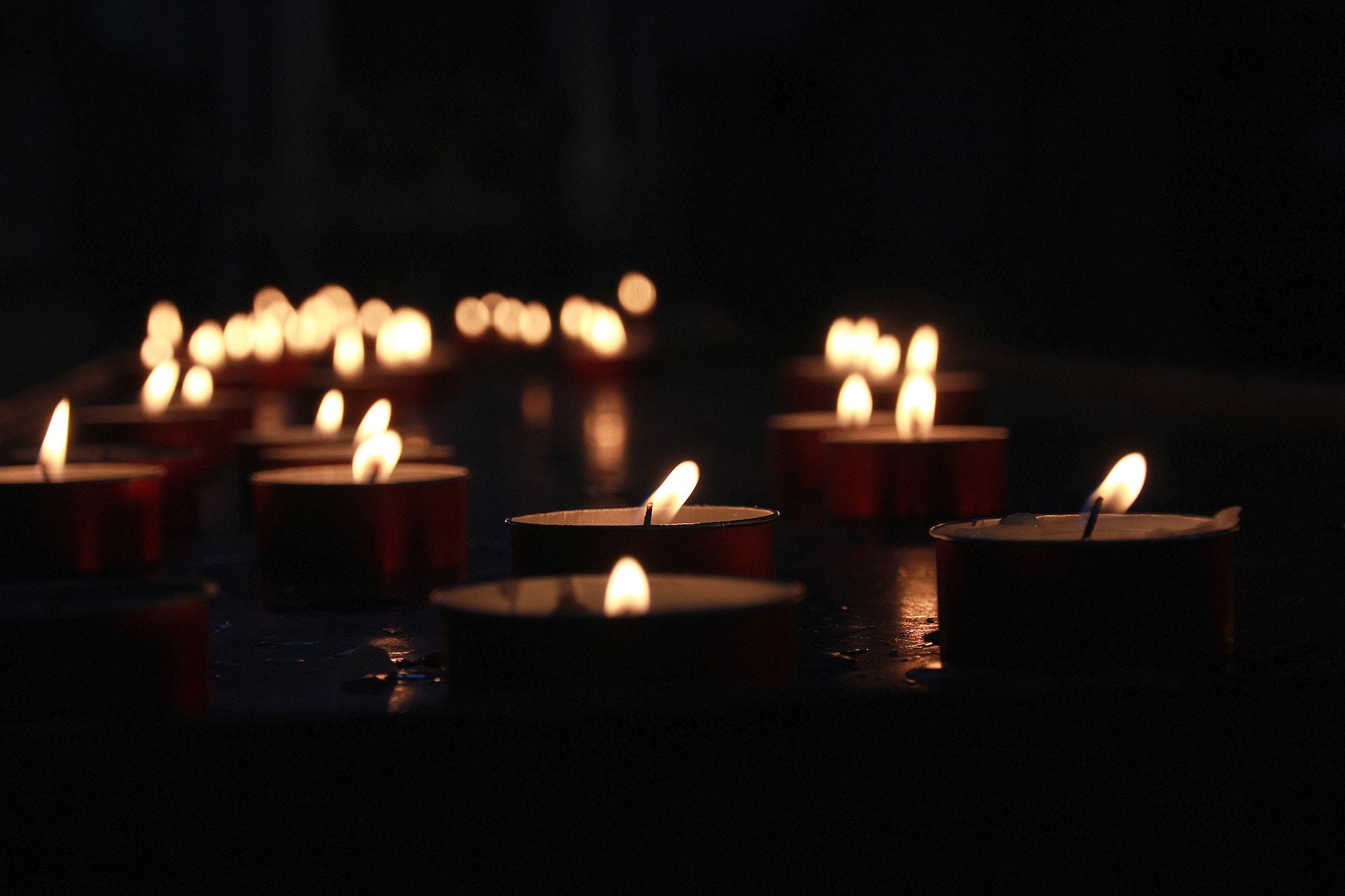 Lit tea light candles