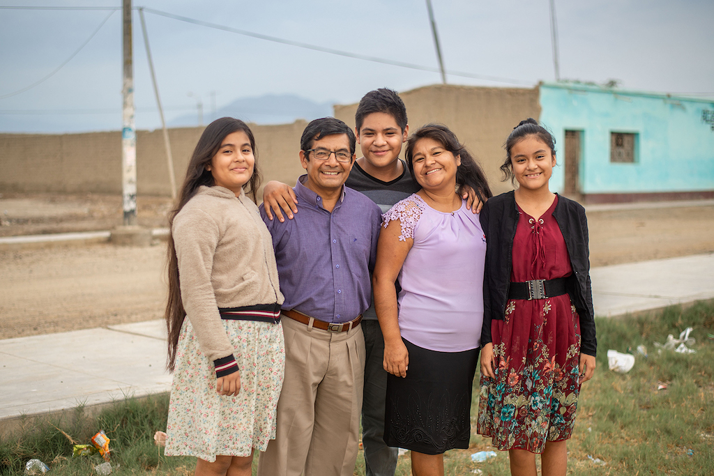 A photo of Pastor Dario's family, including his wife and three teenage kids.
