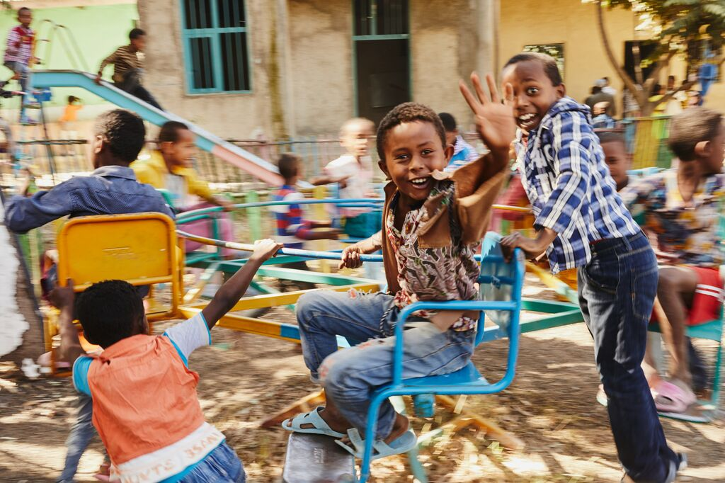 Boys on a playground laughing
