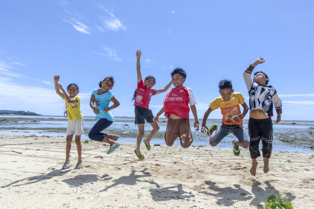 A group of children jumping.