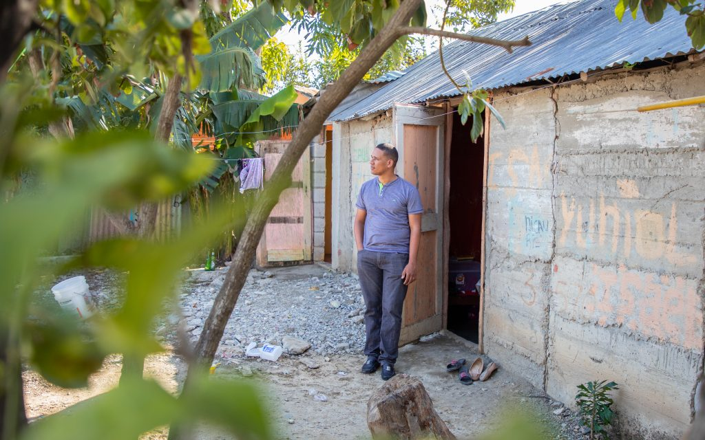Jose outside of his old home.