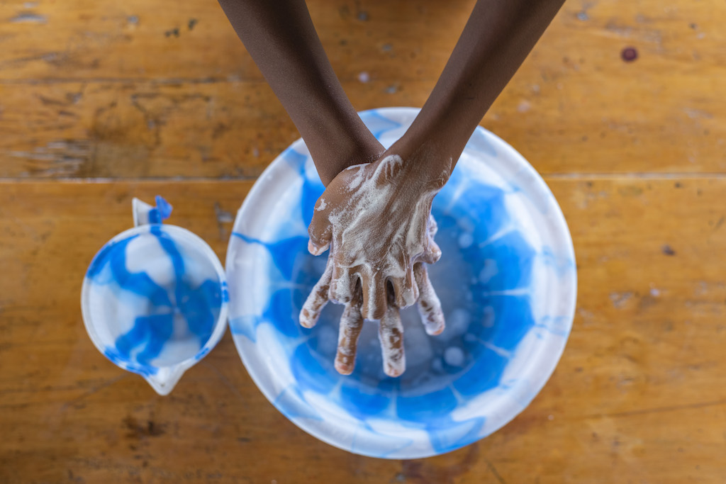 A pair of hands being washed.