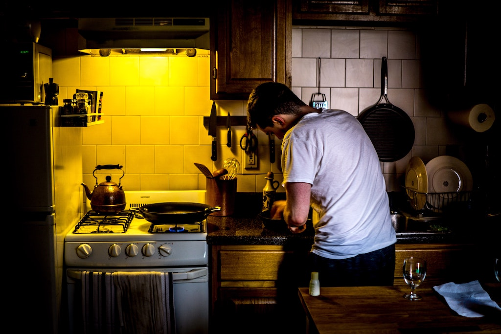 A man cooking in his kitchen.