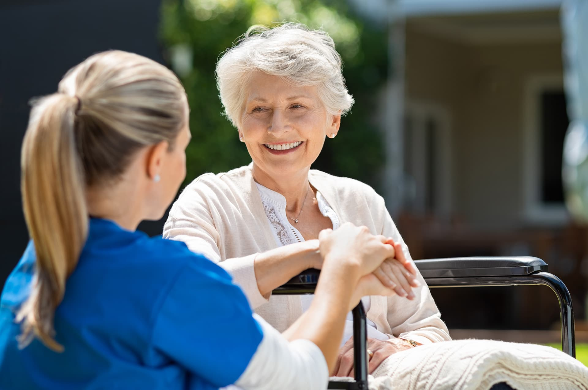Nurse caring for a patient in an assisted living facility with insurance