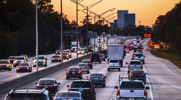 Auto insurance for many cars, trucks, SUVs and vans on a busy highway