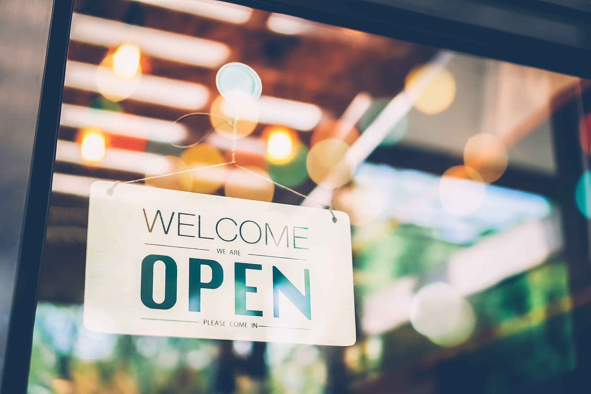 Open sign for businesses with commercial business insurance